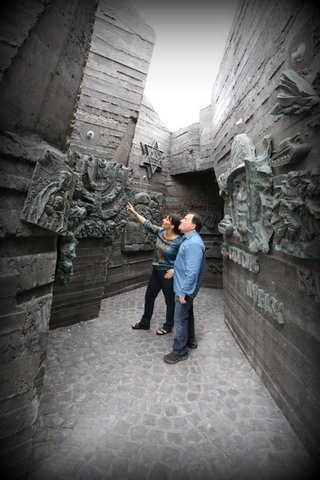 We are standing inside a  gift to Israel from Russian sculptors  -- a Holocaust memorial that opens to giant wings!