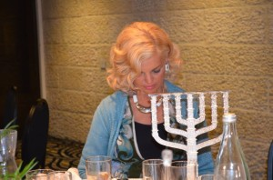 Rosemary Schindler with engraved menorah