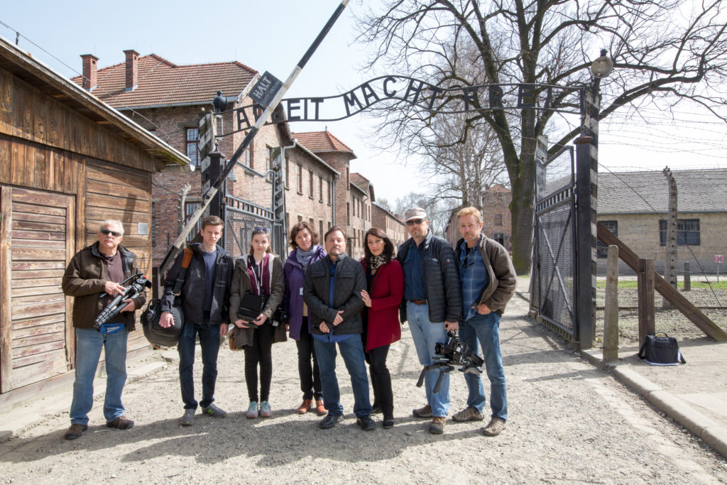 Rev. and Katharine Weiss (4th and 3rd from right) with other members of the production team at the infamous Auschwitz-Birkenau death camp / photo: Ken Berg -- Zola Levitt Ministries (far right)